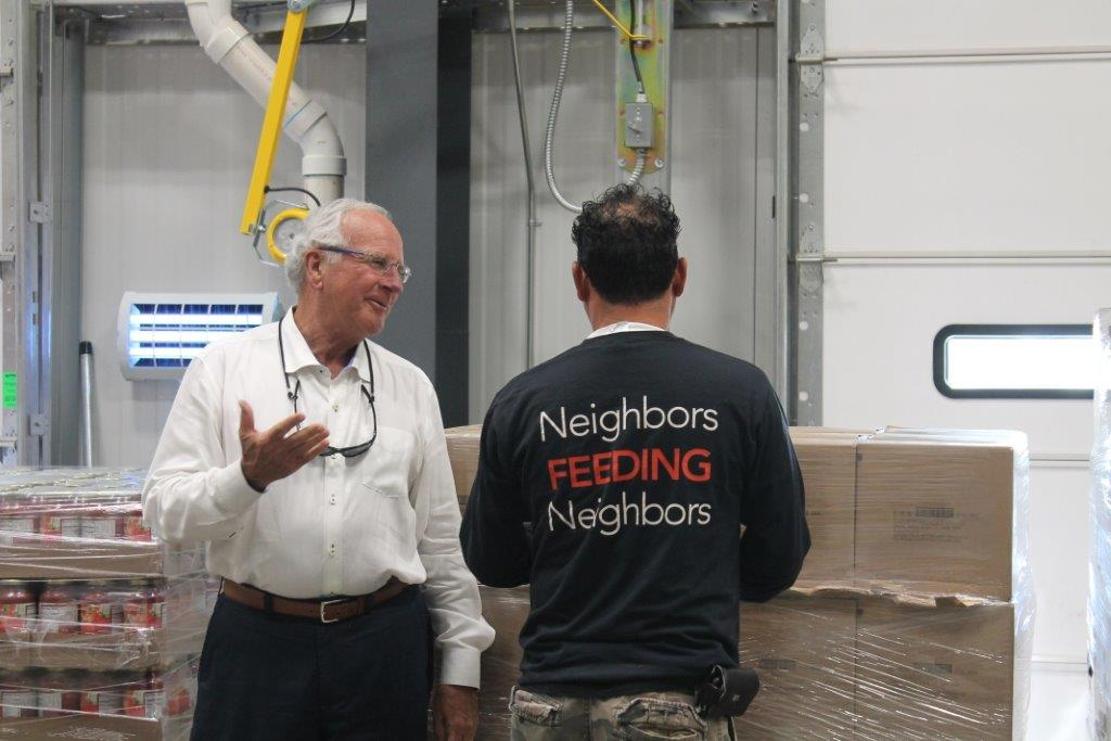 Picture of Robert Taylor, The United Family president, remarks with a South Plains Food Bank team member that neighbors feeding neighbors is really what efforts like this are all about - taking care of the families we serve.